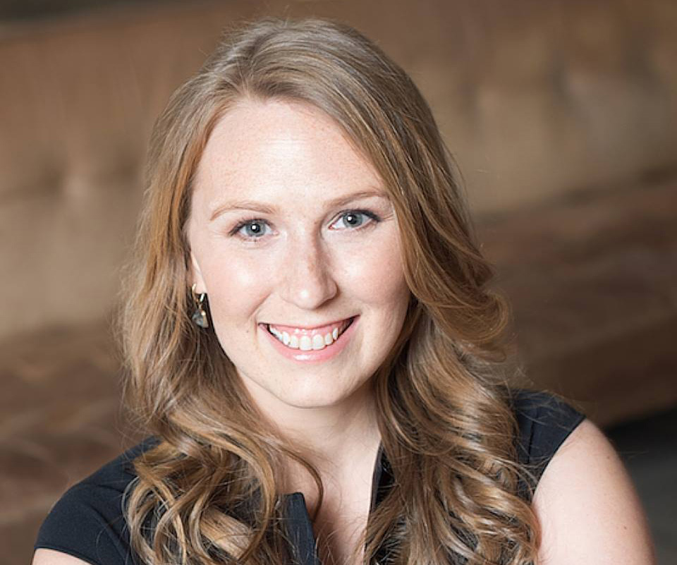 A photo of Casandra Campbell of Shopify smiling