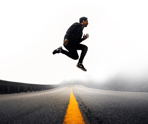 A photo of a Nike athlete running jumping in Nike shoes and gear