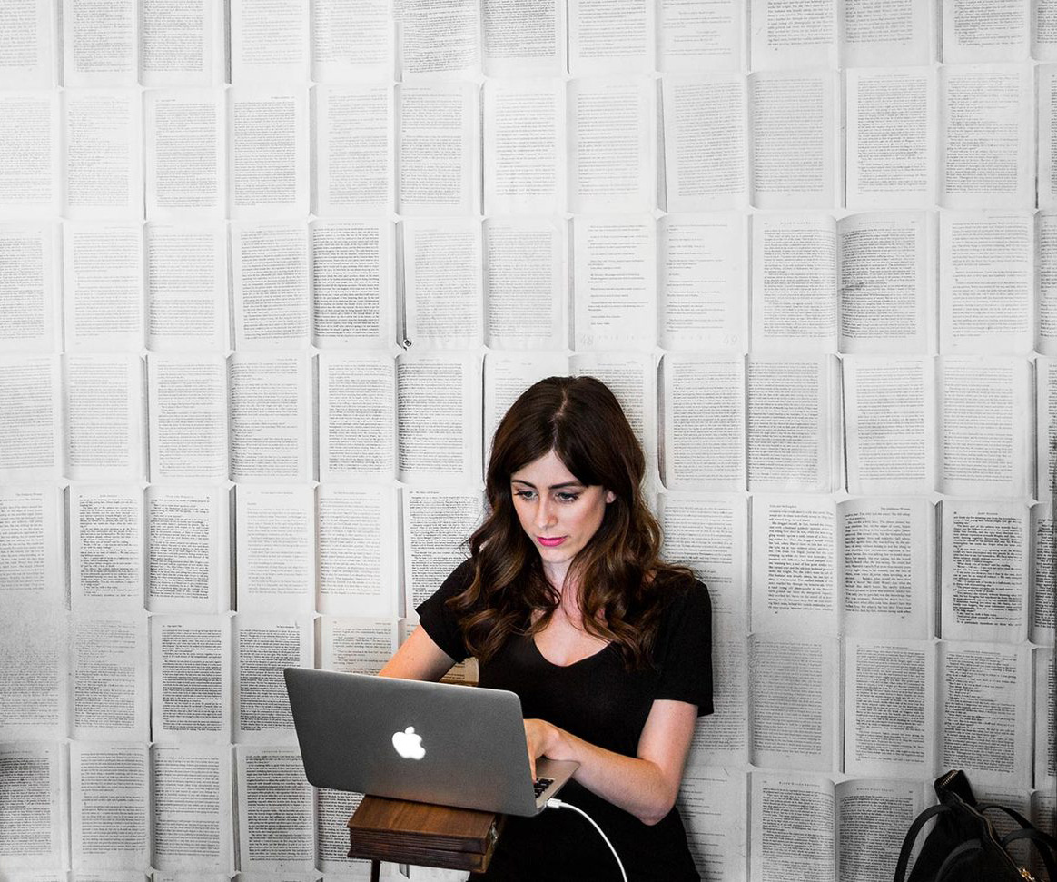 A photo of Allison Esposito working on a computer