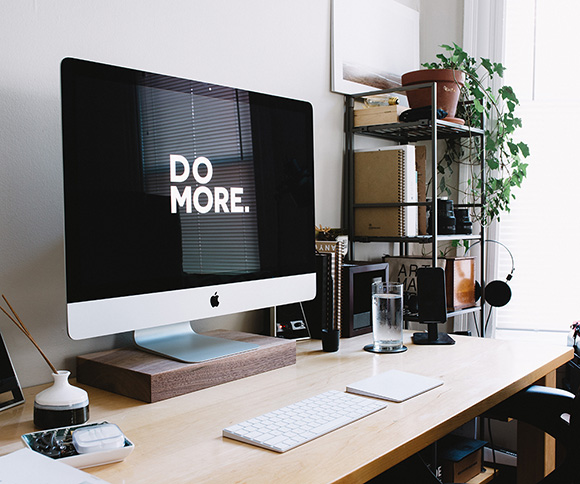 A photo of a desktop setup with the slogan, Do More