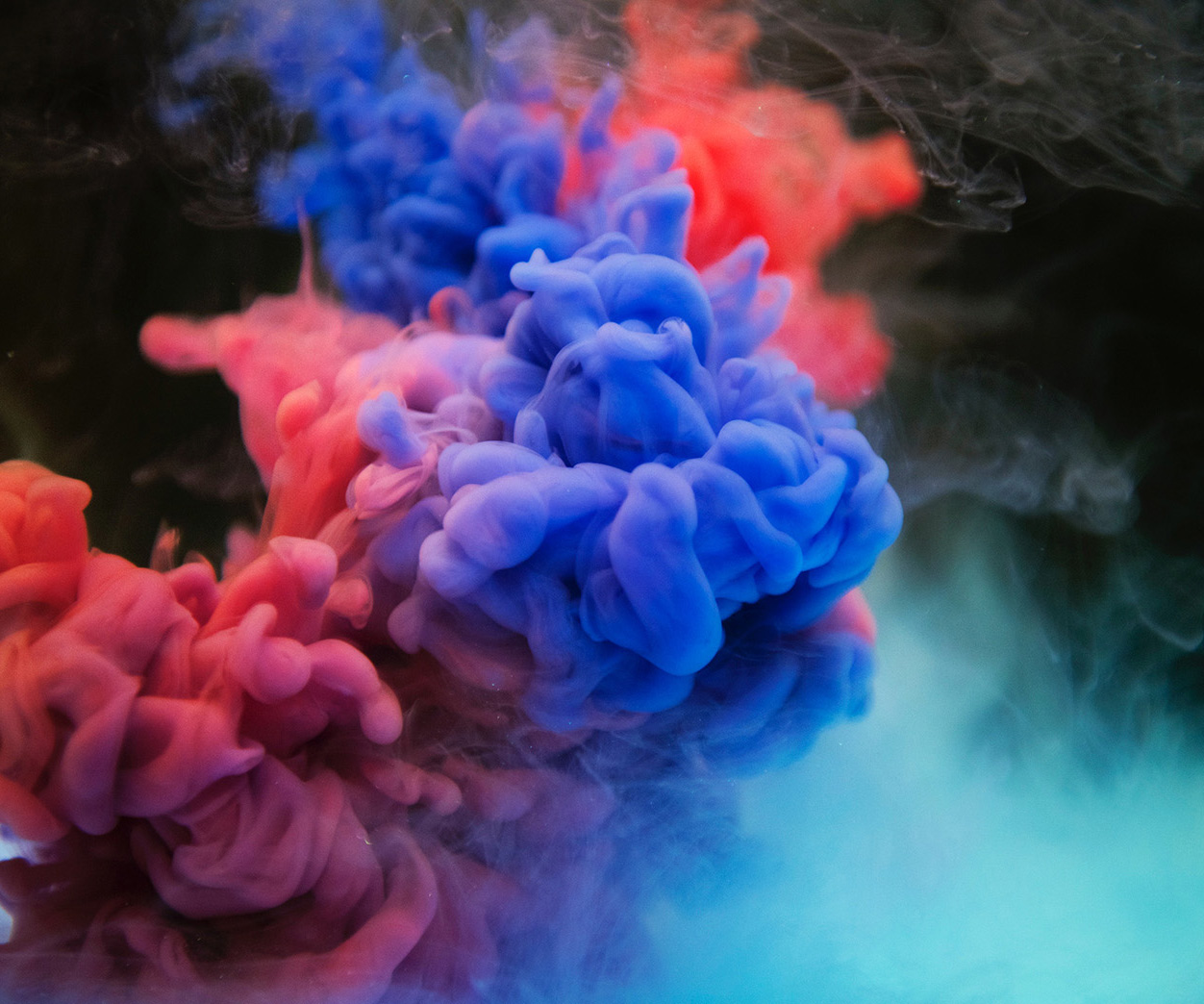 A photo of cloud of thick, colorful smoke