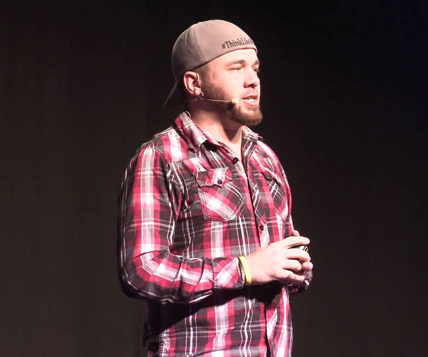A photo of Brian Fanzo speaking on stage