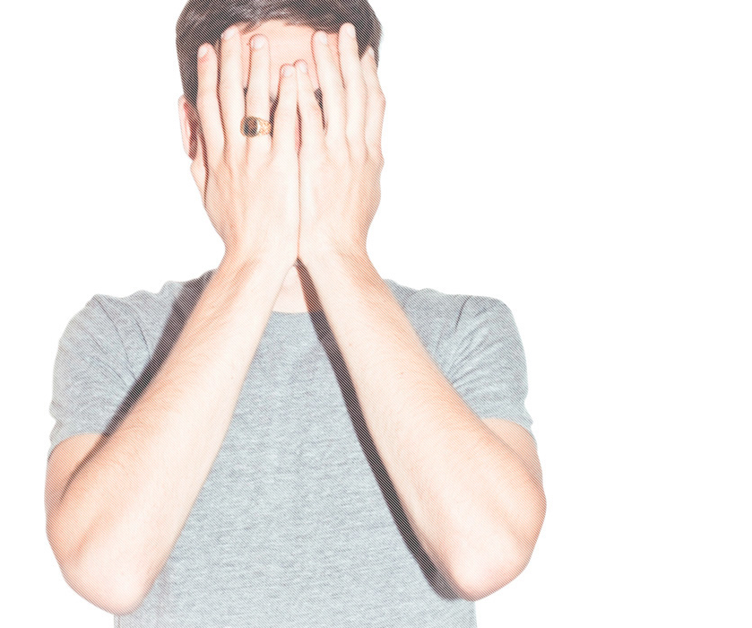 A photo of Ryan Holiday covering his face with his hands