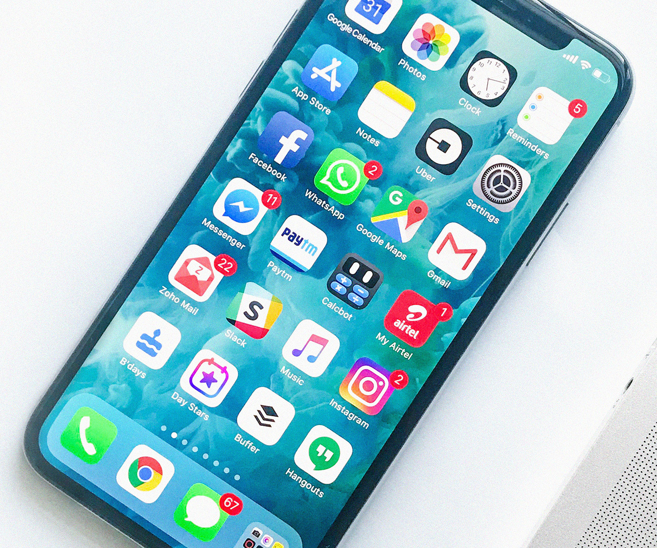 A photo of an iPhone with multiple apps showing on the home screen