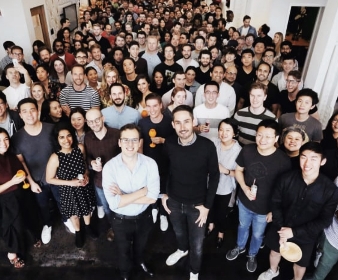A photo of the co-founders of Instagram along with a large group of Instagram employees