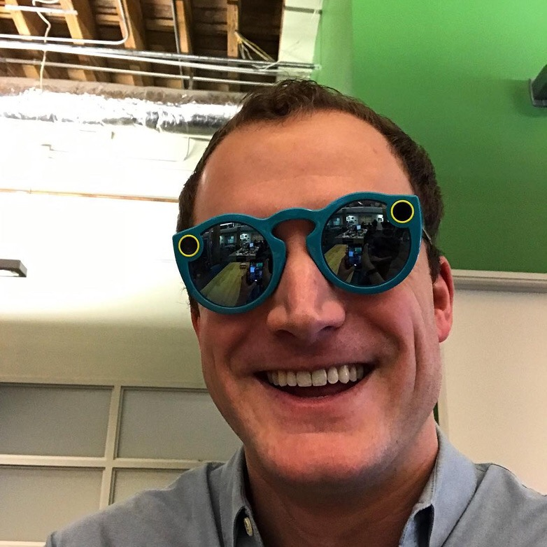 A photo of Travis Bernard wearing Snapchat Spectacles